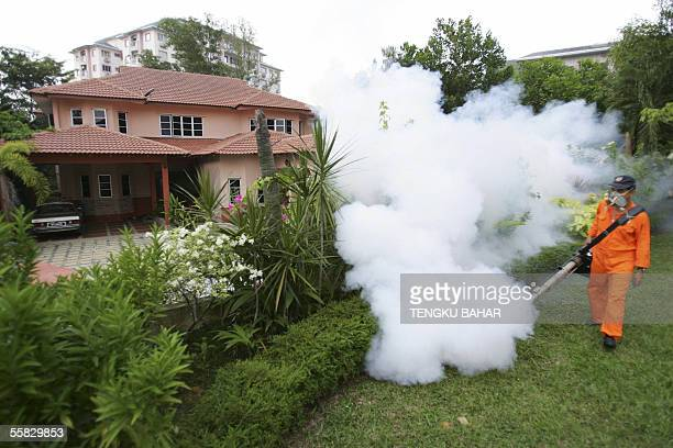 A municipal council worker dispenses insecticide using a fogging machine at a residential suburb in Shah Alam near Kuala Lumpur 30 September 2005...