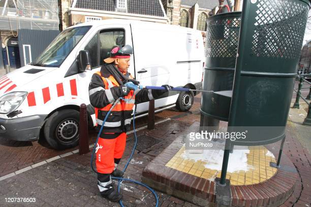 A municipal employee cleans a public urinal at the Red Light District on March 16 2020 in AmsterdamNetherlands Dutch government ordered the closing...