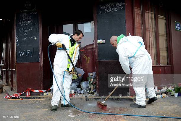 Municipal employees clean the blood outside Le Carillon bar, the day after a deadly attack on November 14, 2015 in Paris, France. At least 120 people...