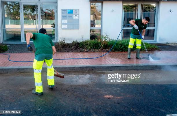 Municipal employees clean up in front of La Republique en Marche party office of French MP Monique Iborra in Tournefeuille near Toulouse on August 2...