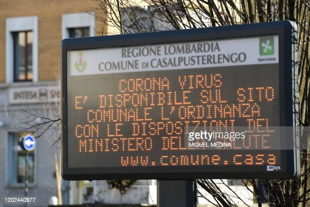 A municipal information sign reads Coronavirus the ordinance with the requirements of the Ministry of Health is available on the municipal website is...