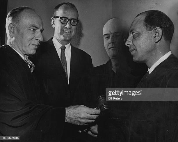 NOV 1961 NOV 22 1961 FEB 4 1963 Municipal Judge begins Duties George Manerbino right former deputy city clerk is welcomed to the Municipal court...