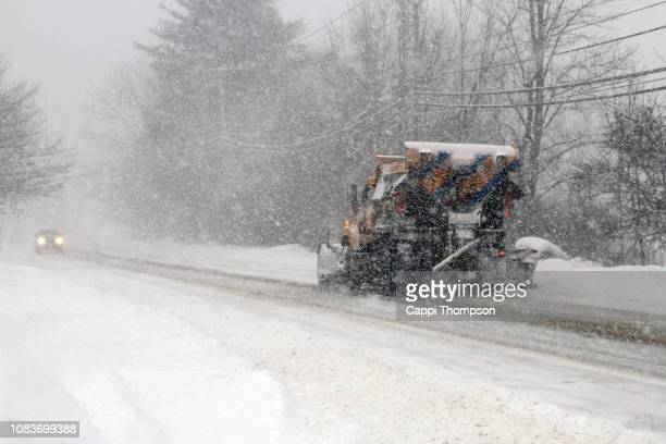 municipal plow truck plowing snow off roadways in laconia, new hampshire usa - road salt stock pictures, royalty-free photos & images