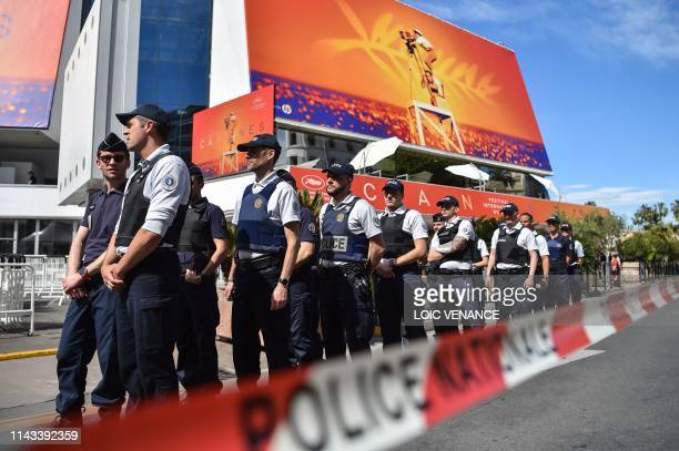 Municipal Police officers patrol past the Festival's palace during a security drill on May 13 2019 on the eve of the opening of the 72nd Cannes Film...