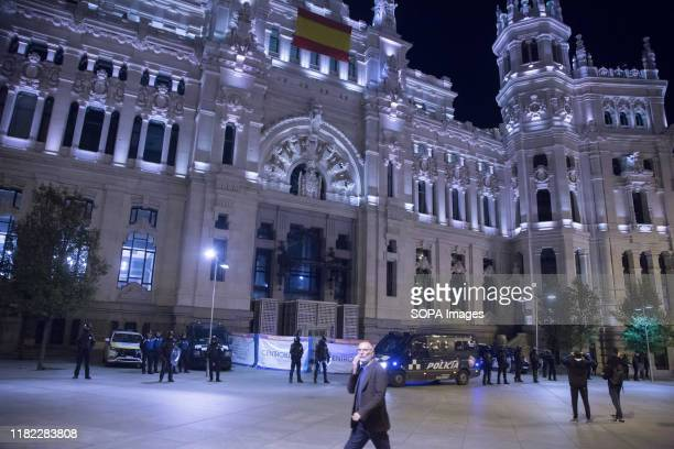 Municipal policemen stand on guard at the Madrid City Council during the protest. The municipal police evicted without prior notice the self-managed...