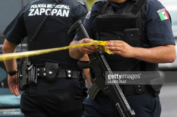 Municipal policemen work in a crime scene after a 40year man was shot dead in Zapopan state of Jalisco Mexico on July 31 2018 Mexican Presidentelect...