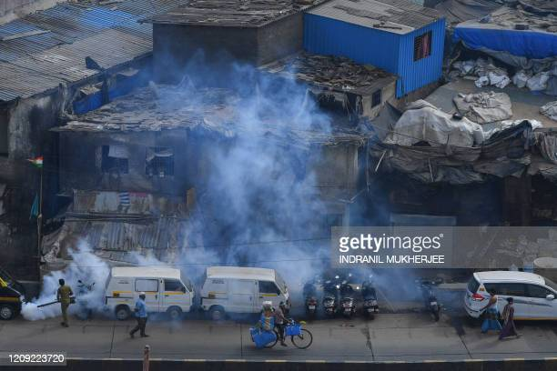 Municipal staff fumigates inside the Dharavi slum during a governmentimposed nationwide lockdown as a preventive measure against the spread of the...