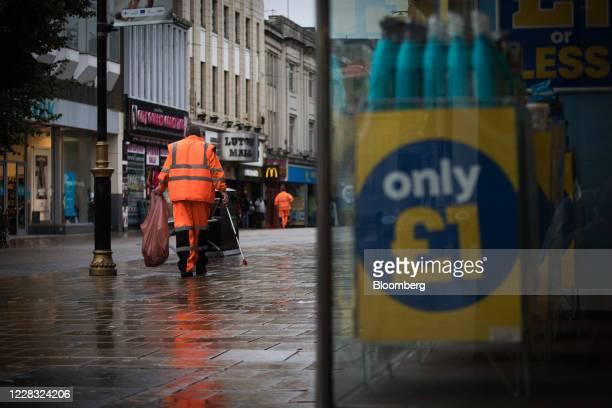 Municipal street cleaner passes along a pedestrianized shopping precinct in Luton, U.K., on Wednesday, Sept. 2, 2020. TheBank of Englandis touting...