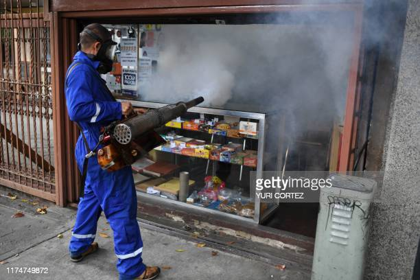Municipal worker fumigates a store against the aedes aegypti mosquito, vector of dengue fever, Zika fever and chikunguya, in El Dorado neighborhood,...