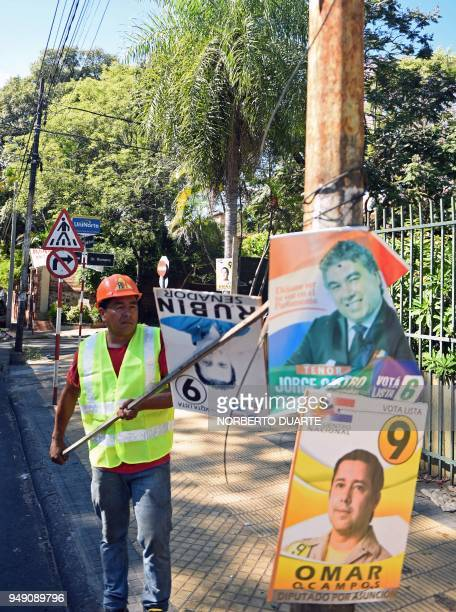 A Municipal worker removes electoral propaganda due to the ban of promoting candidates ahead of the upcoming April 22 presidential elections in...