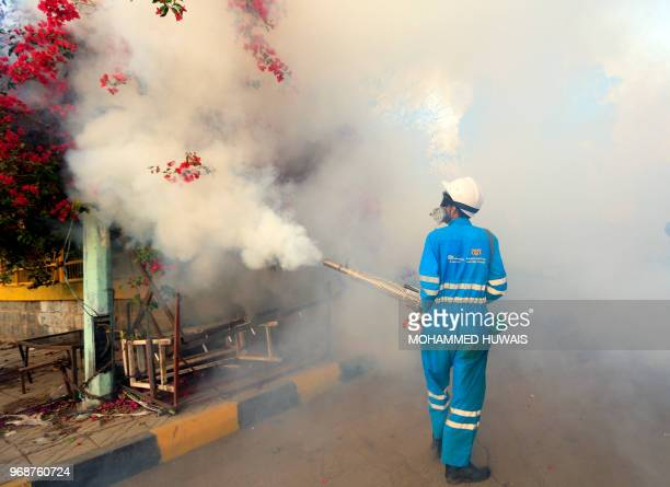 TOPSHOT A municipal worker sprays cholera antiseptics in the Yemeni capital of Sanaa on June 7 during a cholera campaign in markets and public places