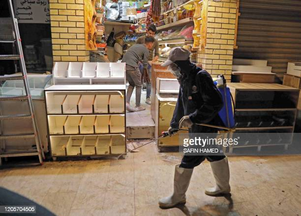 A municipal worker sprays disinfectant in the old market in Arbil the capital of the northern Iraqi Kurdish autonomous region on March 7 as a...