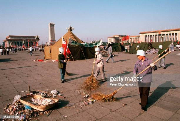 Municipal workers clean up litter rubbish and garbage collected during the prodemocracy demonstrations in Tiananmen Square Prodemocracy demonstrators...