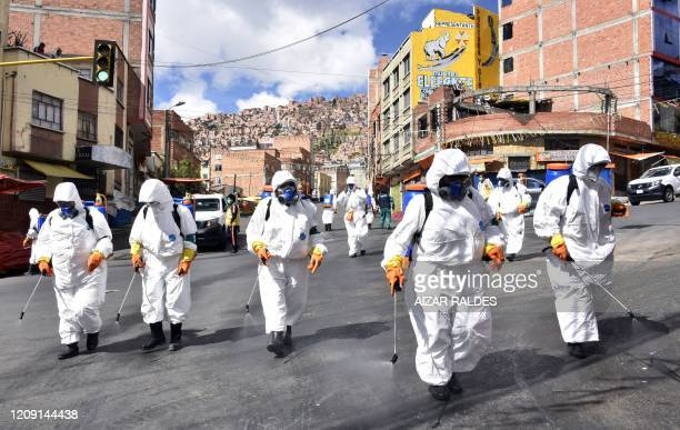 Municipal workers disinfect the streets of La Paz on April 4, 2020 as a preventive measure to slow the spread of the novel coronavirus, COVID-19. -...