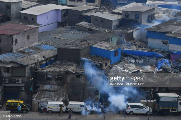 Municipal workers fumigate inside the Dharavi slum during a governmentimposed nationwide lockdown as a preventive measure against the spread of the...