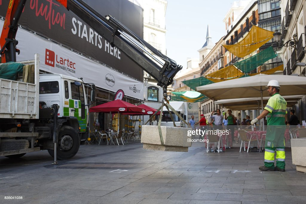 Municipal workers place street furniture on Puerta del Sol street as a security measure to prevent vehicle access in Madrid, Spain, on Friday, Aug. 18, 2017. Terrorists behind the Barcelona attack had planned a devastating assault with explosives and may have rammed pedestrians with vehicles after their initial plan failed, the police chief heading the investigation said on Friday. Photographer: Angel Navarrete/Bloomberg via Getty Images
