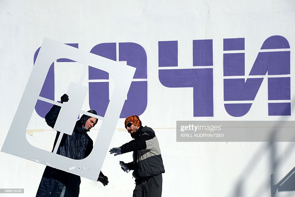 Municipal Workers Prepare To Stencil Olympic Symbols During An