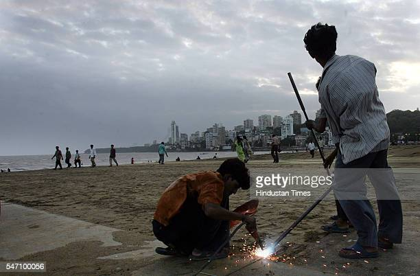 Municipal workers preparing a metal floor as a part of preparations on the eve of Anant Chaturdashi at Girgaum Chowpatty on Friday