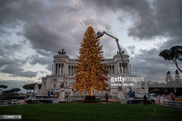 """Municipal workers put up decoration on the big and official Christmas tree so called """"Spelacchio"""" at Piazza Venezia during the restrictions to..."""