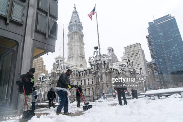 Municipal workers shovel snow on March 7 2018 in Philadelphia Pennsylvania This is the second nor'easter to hit the Northeast within a week and is...