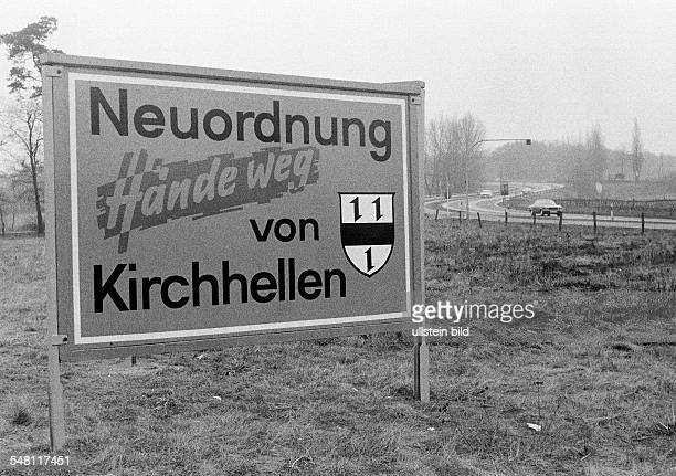 Municipality reform in Germany in the period between 1967 and 1978, communal reorganization, signboard on a willow near a country road indicating a...