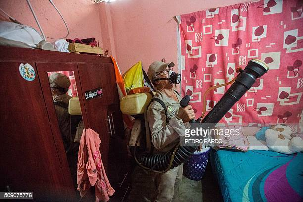 Municipality worker fumigates a home against the Aedes aegypti mosquito to prevent the spread of Zika, Chikungunya and Dengue in Acapulco, Guerrero...