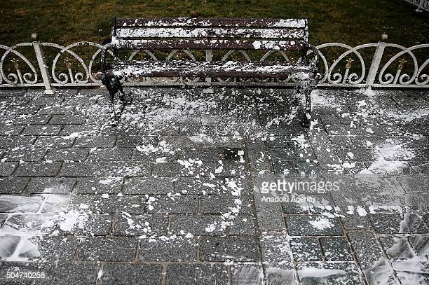 Municipality workers clean the Sultanahmet square after it has been reopened to media and public in Istanbul Turkey on January 13 2016 A blast at...