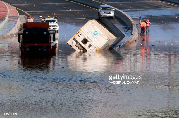 Municipality workers try to drain a flooded underpass in Kuwait City on November 6 as a result of the accumulation of rainwater