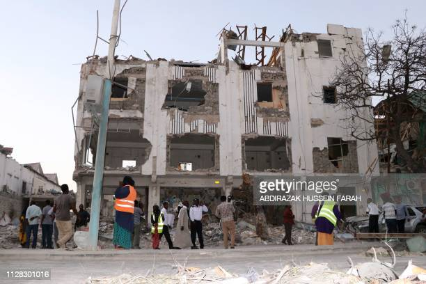 Municiple workers begin to clear the area outside the Maka Al-Mukarama hotel in the Somalia capital, Mogadishu on March 1, 2019 after a car bomb...