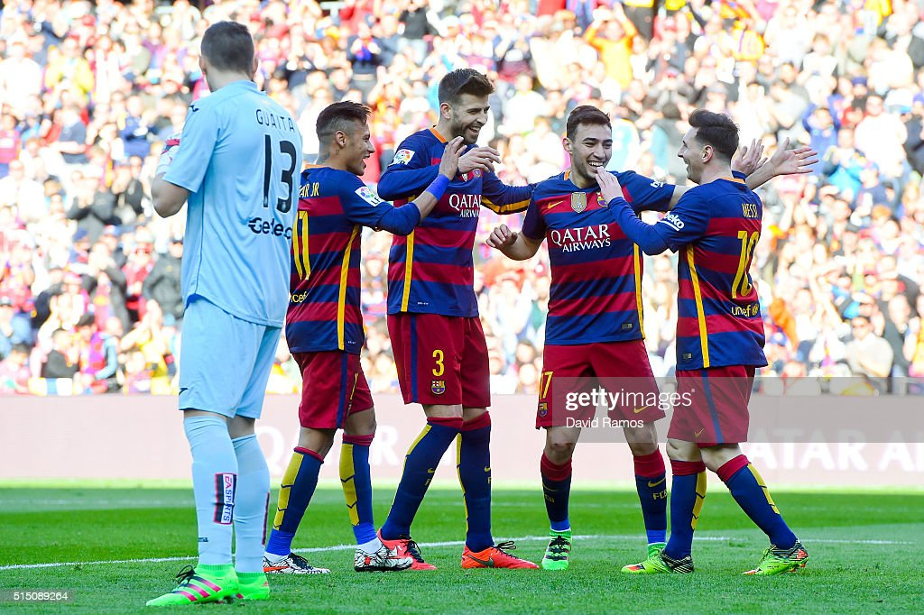 Munir el Haddadhi (2ndR) celebrates with his teammates Neymar (L) Gerard Pique (2ndL) and Lionel Messi of FC Barcelona after scoring his team's second goal of FC Barcelonaduring the La Liga match between FC Barcelona and Getafe CF at Camp Nou on March 12, 2016 in Barcelona, Spain.