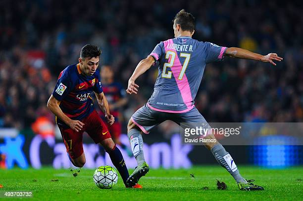Munir el Haddadhi of FC Barcelona competes for the ball with Diego Llorente of Rayo Vallecano during the La Liga match between FC Barcelona and Rayo...