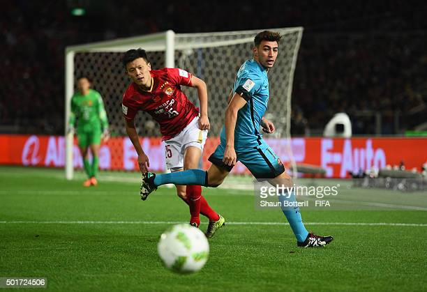 Munir El Haddadi of Barcelona and Zou Zheng of Guangzhou Evergrande FC challenge for the ball during the FIFA Club World Cup Semi Final match between...