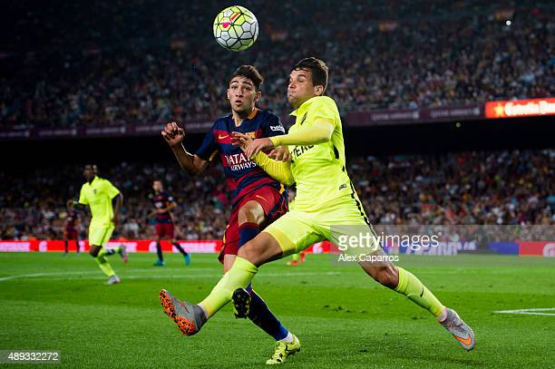 Munir El Haddadi of FC Barcelona and Antonio 'Tono' Garcia of Levante UD fight for the ball during the La Liga match between FC Barcelona and Levante...