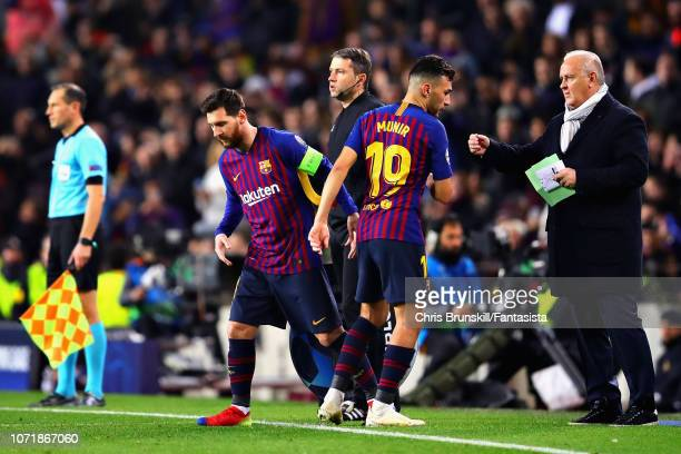 Munir El Haddadi of FC Barcelona is replaced by teammate Lionel Messi as a substitute during the UEFA Champions League Group B match between FC...