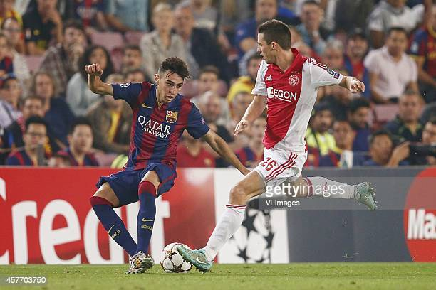 Munir El Haddadi of FC Barcelona Nick Viergever of Ajax during the group F Champions League match between Barcelona and Ajax Amsterdam on October 21...