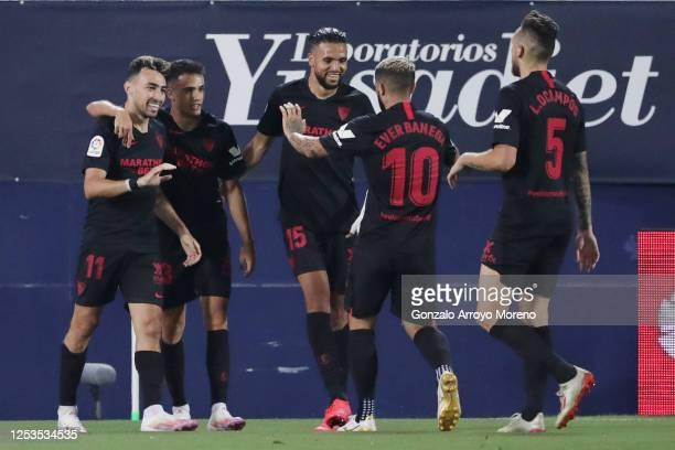 Munir El Haddadi of Sevilla celebrates with teammates after scoring his team's third goal during the Liga match between CD Leganes and Sevilla FC at...