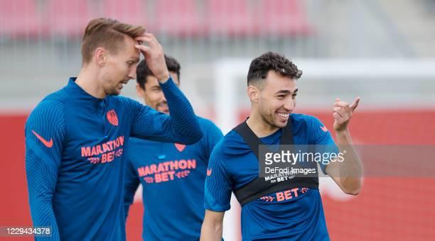 Munir El Haddadi of Sevilla FC and Luuk De Jong of Sevilla FC look on ahead of the UEFA Champions League Group E stage match between FC Sevilla and...