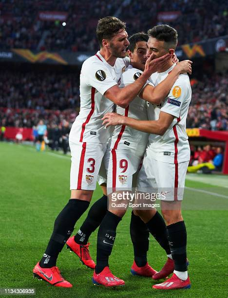 Munir El Haddadi of Sevilla FC celebrates scoring his team's second goal with team mates during the UEFA Europa League Round of 16 First Leg match...