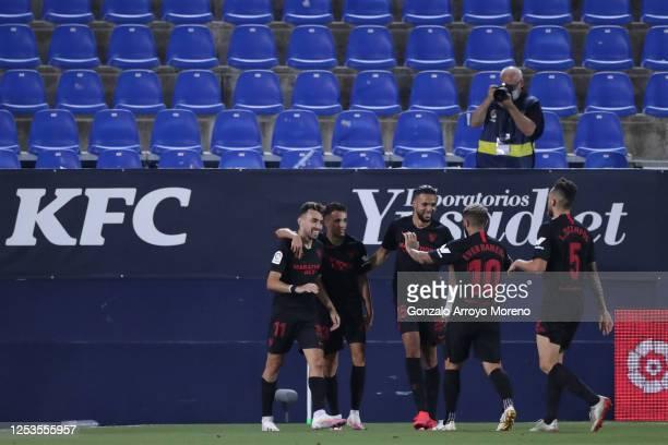 Munir El Haddadi of Sevilla FC celebrates scoring their third goal with teammates Sergio Reguilon Youssef EnNesyri Ever Banega and Lucas Ocampos...