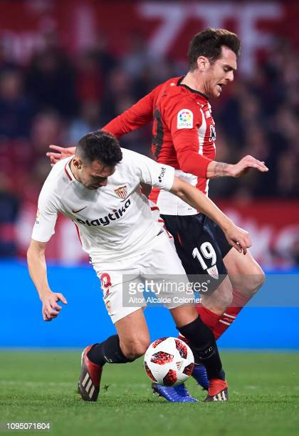 Munir El Haddadi of Sevilla FC competes for the ball with Ibai Gomez of Athletic Club during the Copa del Rey Round of 16 second leg match between...