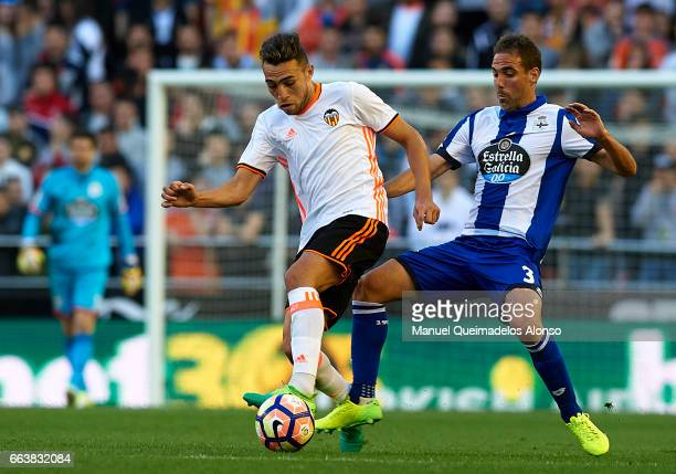 Munir El Haddadi of Valencia is tackled by Fernando Navarro of Deportivo de La Coruna during the La Liga match between Valencia CF and Deportivo de...
