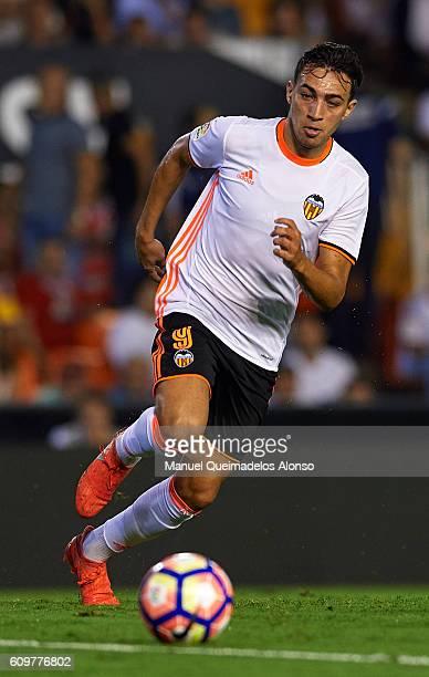 Munir El Haddadi of Valencia runs with the ball during the La Liga match between Valencia CF and Deportivo Alaves at Mestalla Stadium on September 22...