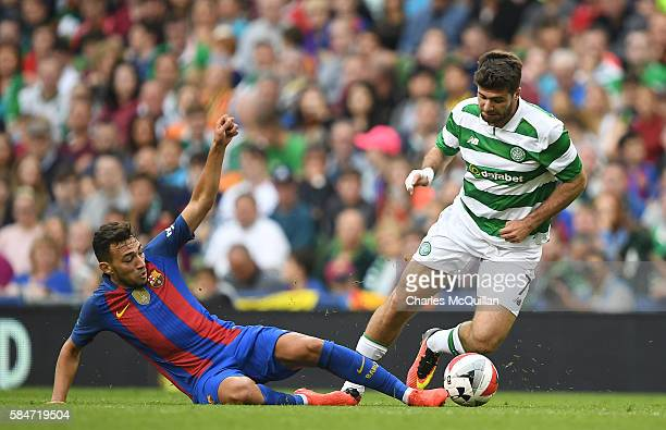 Munir Mohamed of Barcelona and Nadir Ciftci of Celtic during the International Champions Cup series match between Barcelona and Celtic at Aviva...