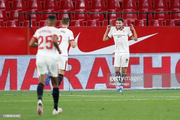 Munir of Sevilla celebrates with teammate Luuk de Jong after scoring his team's fourth goal during the La Liga Santander match between Sevilla FC and...