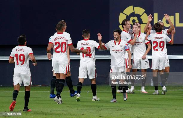 Munir of Sevilla celebrates with teammates after scoring his sides second goal during the La Liga Santander match between Cadiz CF and Sevilla FC at...