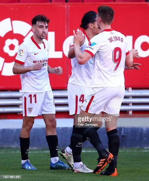 Munir of Sevilla celebrates with teammates Karim Rekik and Luuk de Jong after scoring his team's first goal during the La Liga Santander match...