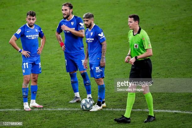 Munir of Sevilla FC Gudelj of Sevilla FC Ever Banega of Sevilla FC referee David Medie Jimenez during the La Liga Santander match between Athletic de...