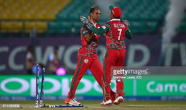 Munis Ansari of Oman celebrates bowling Gary Wilson of Ireland during the ICC Twenty20 World Cup match between Ireland and Oman at the HPCA Stadium...