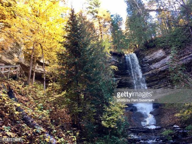 munising falls with fall foliage, pictured rocks national lakeshore - pictured rocks national lakeshore stock pictures, royalty-free photos & images
