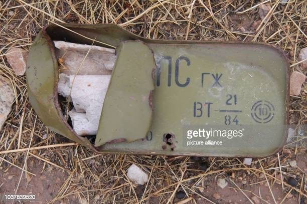 A munitions case lies outside a mass grave near the Sinjar Mountains in Sinjar Iraq 15 December 2016 Sinjar is one of more than 30 nameless towns in...